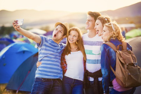 Group of beautiful teens at summer festival Stock Photo