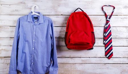 blue shirt: Desk with school supplies. Studio shot on wooden background. Stock Photo