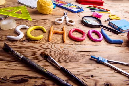Desk with school supplies. Studio shot on wooden background. Zdjęcie Seryjne