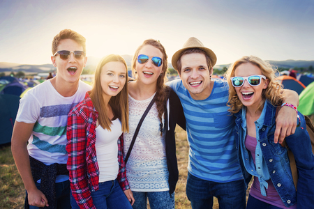 happy group: Group of beautiful teens at summer festival Stock Photo