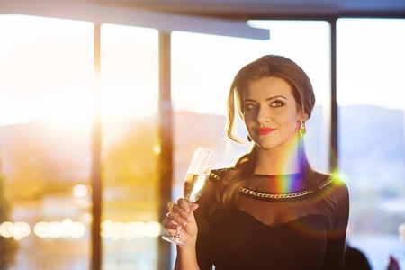 beautiful long hair: Attractive young woman with a drink on a terrace of a bar Stock Photo