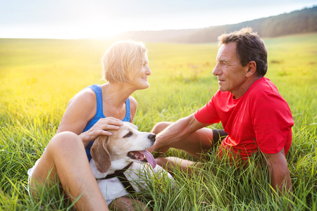couple outdoor: Active seniors having a break during their run outside in green nature