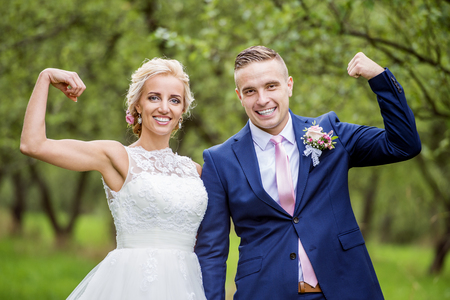Beautiful young wedding couple outside in nature Stock Photo
