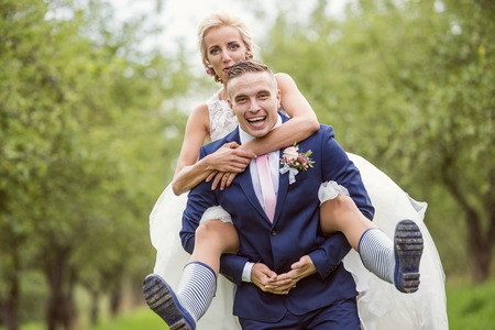 wellies: Beautiful young wedding couple outside in nature Stock Photo