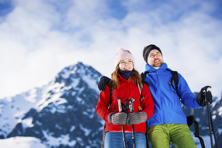 healthy sport: Young couple hiking outside in sunny winter mountains Stock Photo