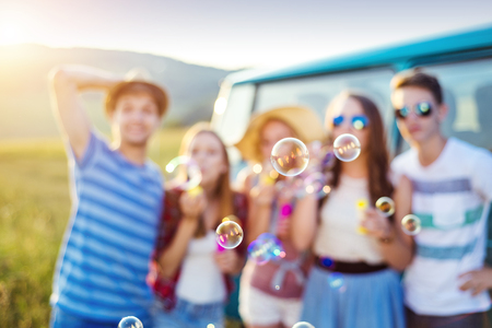 buble: Young hipster friends on road trip on a summer day