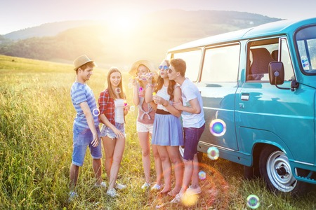 day trip: Young hipster friends on road trip on a summer day
