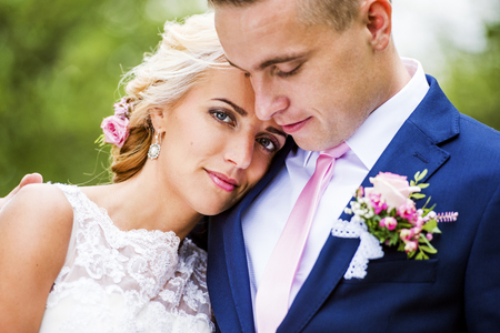 summer dress: Beautiful young wedding couple outside in nature Stock Photo