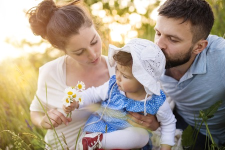 family outside: Happy young family having fun outside in spring nature Stock Photo