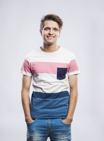 teenagers standing: Stylish handsome young man posing. Studio shot on white background