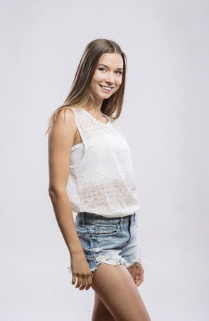 long: Beautiful young hipster girl. Studio shot on white background Stock Photo