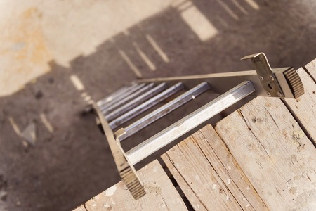 career ladder: Ladder on a construction site. Highg angle view.