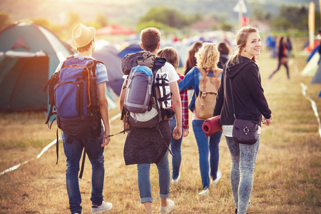 backpack: Group of beautiful teens arriving at summer festival