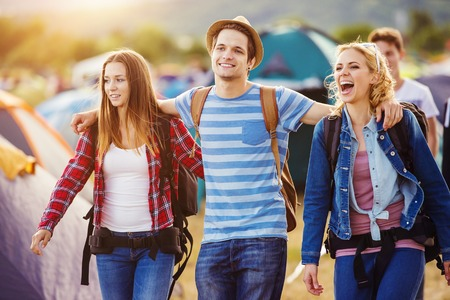smiling teenagers: Group of beautiful teens arriving at summer festival