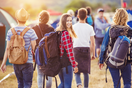 summer fun: Group of beautiful teens arriving at summer festival