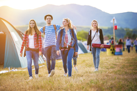 coming together: Group of beautiful teens arriving at summer festival