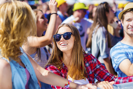 summer festival: Group of beautiful teens at concert at summer festival
