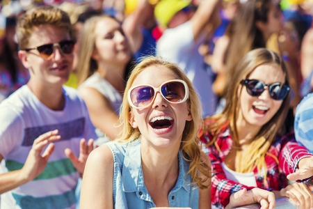 man outdoors: Group of beautiful teens at concert at summer festival