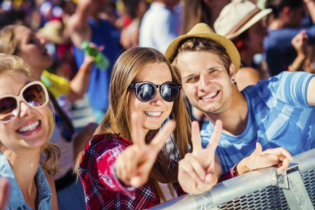Group of beautiful teens at concert at summer festival Imagens - 45742538