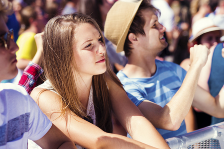 people: Group of beautiful teens at concert at summer festival