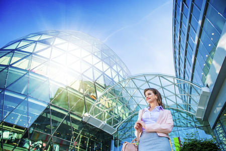 commercial building: Attractive young business woman in front of the mall