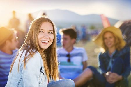 teens: Group of beautiful teens camping at summer festival