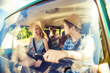 drive: Beautiful young people on a road trip on a summers day Stock Photo