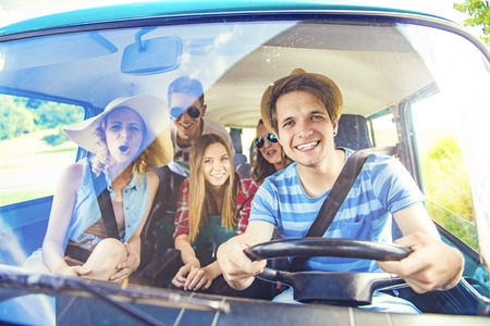 vans: Beautiful young people on a road trip on a summers day Stock Photo