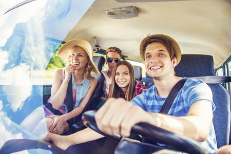 drive car: Beautiful young people on a road trip on a summers day Stock Photo