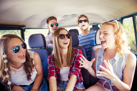 Beautiful young people on a road trip on a summers day Standard-Bild
