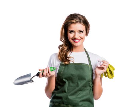 Mooie jonge vrouw in mosterd trui. Studio opname op witte achtergrond. Stockfoto - 46077366