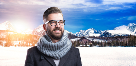stylish man: Handsome young man enjoying a walk in mountains Stock Photo