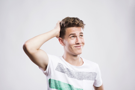men standing: Stylish handsome young hipster posing. Studio shot on white background