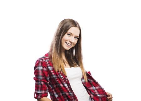 jovenes felices: La muchacha hermosa joven inconformista. Estudio tirado en el fondo blanco Foto de archivo