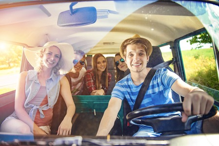 spring hat: Young hipster friends on road trip on a summers day Stock Photo