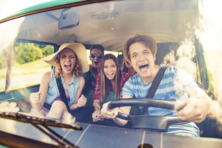 summers: Young hipster friends on road trip on a summers day Stock Photo
