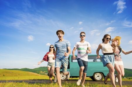 travelling: Young hipster friends on road trip on a summers day Stock Photo