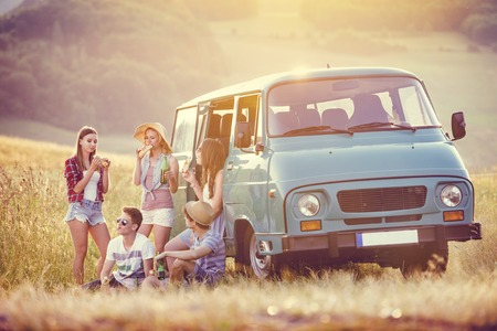 road of love: Young hipster friends on road trip on a summers day Stock Photo