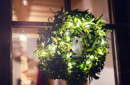 welcome door: Green mistletoe wreath hang on glass door