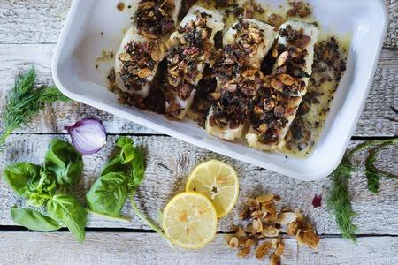 zander: Zander fish fillets in green ceramic dishware