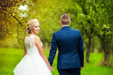 woman dress: Beautiful young wedding couple outside in nature Stock Photo