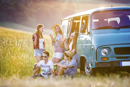 friendships: Young hipster friends on road trip on a summer day