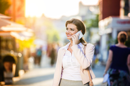 woman on phone: Beautiful young business woman with smart phone Stock Photo