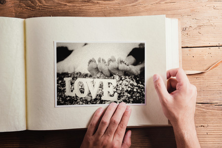 wedding photo album: Black and white picture in photo album. Studio shot on wooden background.