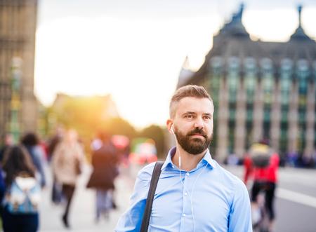 westminster bridge: Handsome young man in blue shirt on Westminster bridge