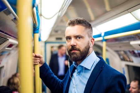 people   lifestyle: Young handsome businessman with smartphone in subway Stock Photo