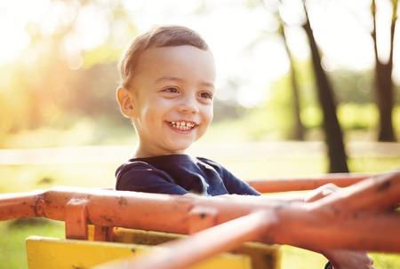 go up: Cute little boy having fun on playground