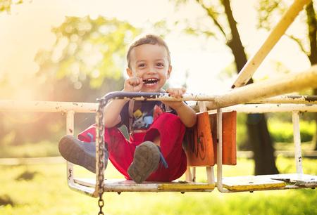 on playground: Cute little boy having fun on playground