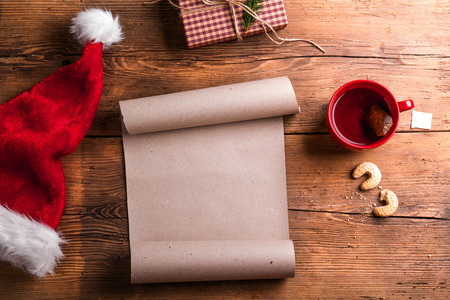 Empty wishlist for Santa Claus laid on a wooden table Stok Fotoğraf - 47169640