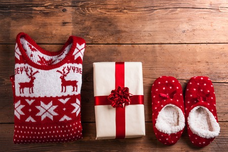 merry time: Christmas presents laid on a wooden table background Stock Photo